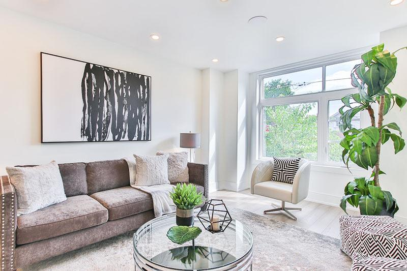 Beautiful living room with newly painted walls. Making cosmetic updates to your home is an example of simple home renovations to increase home value.