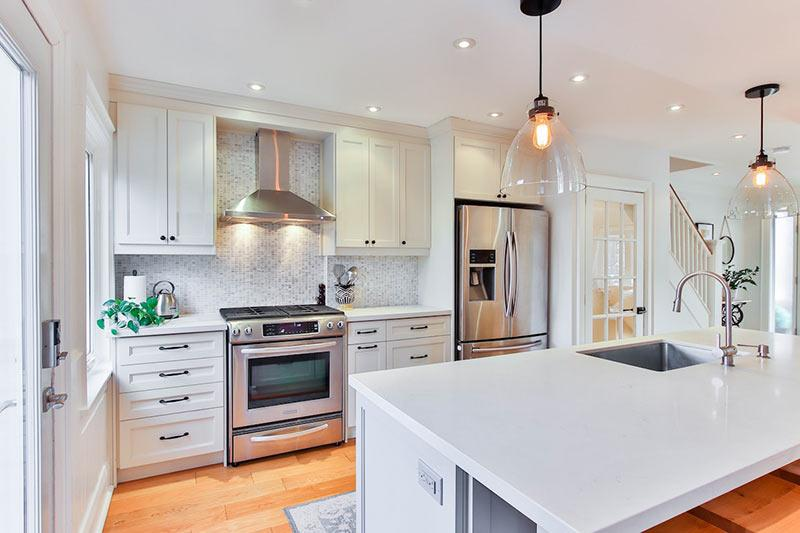 Kitchen with stylish backsplash and new appliances. Example of a kitchen renovation that will boost home value.
